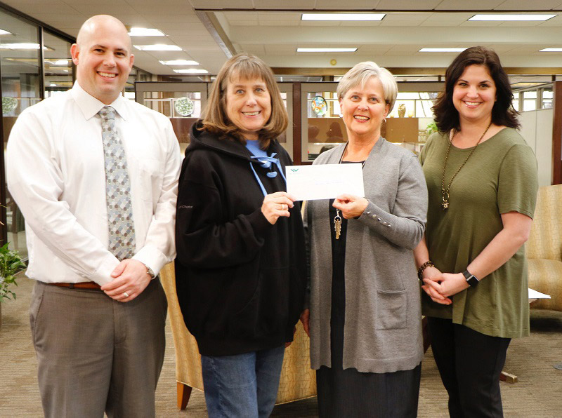Bank employees presenting the Habitat for Humanity check